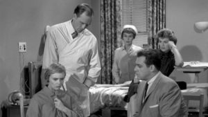Perry Mason interviews the demure defendant.
