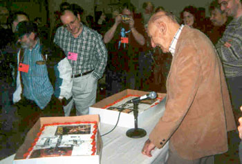 Hugh B. Cave looks at the cakes decorated with icing sporting covers of some of the pulp magazines for which he wrote. The cakes were presented by fans at the Windy City pulp show. (Photo: Conrad V. Sucatre)