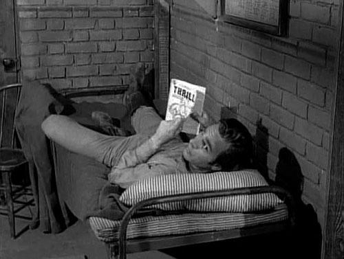 "Chester reads a pulp magazine on ""Gunsmoke"""