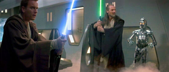 "Jedis Obi-Wan Kenobi (Ewan McGregor) and Qui-Gon Jinn (Liam Neeson) stand ready for battle in ""Star Wars, Episode I: The Phantom Menace."""