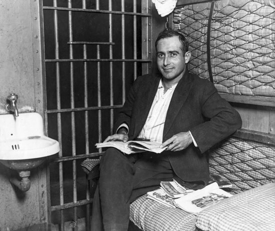 Albert Martin reading pulps in his San Francisco jail cell.
