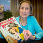 PulpFest Guest of Honor Gloria Stoll Karn graciously spent time after her presentation signing pulps featuring covers she painted.